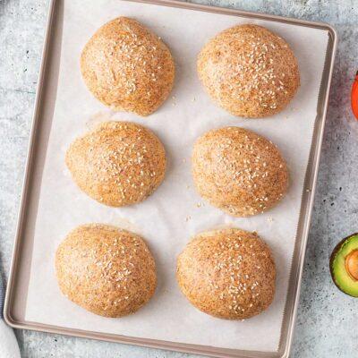 6 keto bread rolls on a baking tray.