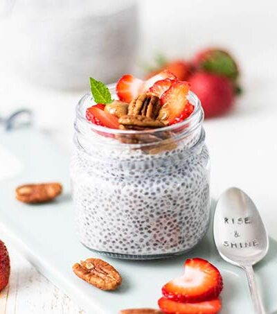 A healthy low carb chia seed pudding recipe shown served with berries and nuts.