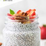 A close up look at a jar of keto chia pudding topped with nuts and berries.