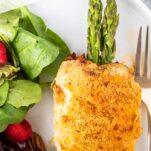 A close up at a chicken breast stuffed with asparagus and cheese.