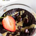 A close up of a coconut flour mug cake drizzled with sunflower seed butter.
