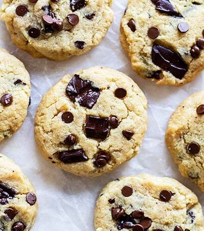A bunch of cookies laying on on a piece of crumpled parchment paper.