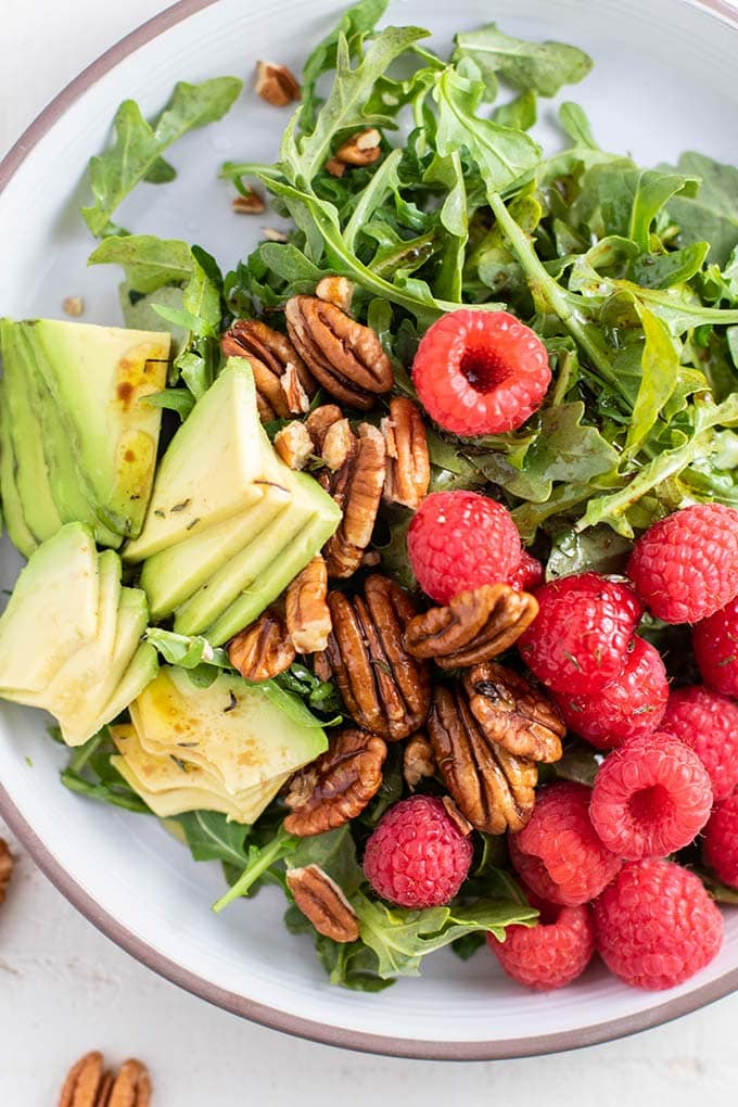 A close up look at a salad showing good options for healthy fats.