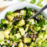 A blue bowl filled with a vibrant avocado salsa with jicama, red onions and jalapeno.