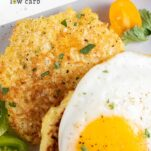 A close up look of 2 cauliflower fritters served with a sunny side up egg.