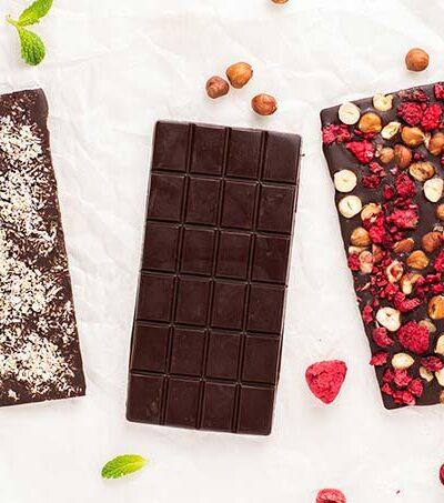 Three keto dark chocolate bars showing different options for customizing the flavor.