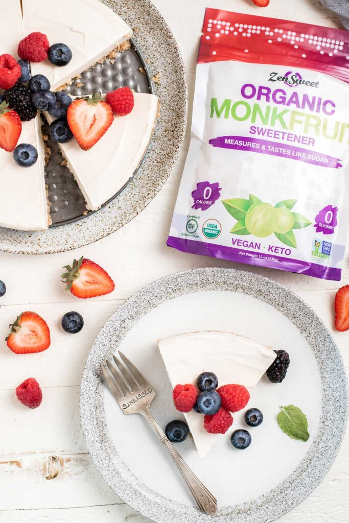 A slice of cheesecake being served next to a bag of monk fruit sweetener.