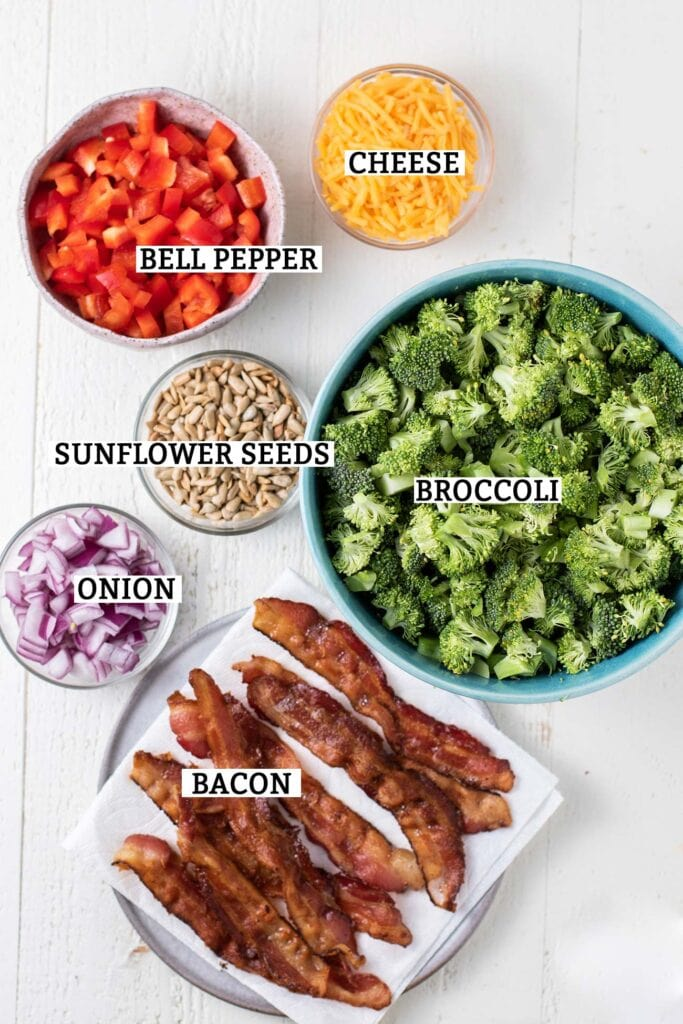 Ingredients for a keto broccoli salad shown prepared and labeled.
