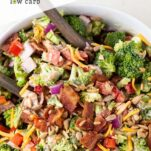 A close up look at the keto broccoli salad with bacon, peppers, sunflower seeds and cheese.