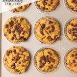 A muffin pan with baked chocolate chip keto pumpkin muffins.