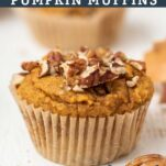 A close up look at a keto pumpkin muffin with pecans.