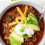 A close up look at a bowl of keto chili with toppings.