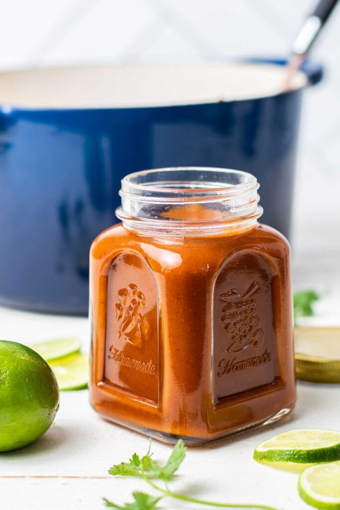 A close up of a jar of enchilada sauce.