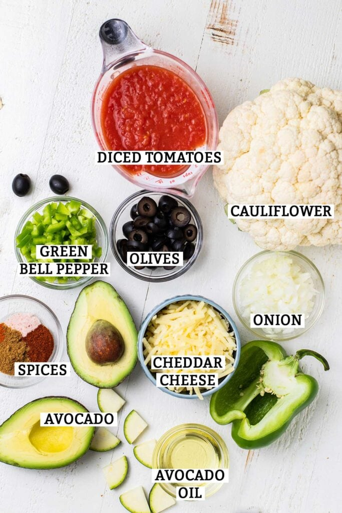 All of the ingredients needed to prepare Mexican cauliflower rice shown ready to be combined.