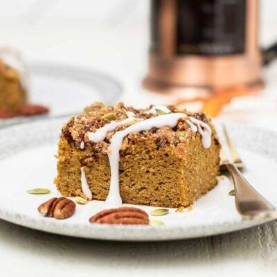A slice of keto coffee cake drizzled with a vanilla glaze.